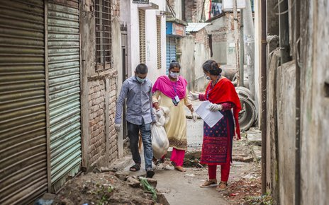 Covid-19 pandemic. Development workers carry relief aid for distribution among the marginalised people, Bashabo, Dhaka..jpg